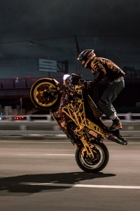 1280x2120 Urban Biker Doing Wheelie