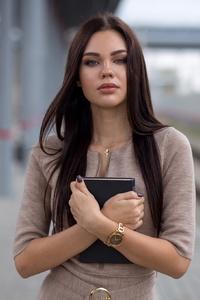 Violetta Milovanova Standing With Book