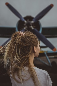 1080x1920 Women Hands In Hair Standing In Front Of Plane 5k