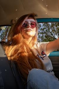 Women Sitting Inside Vehicle 5k